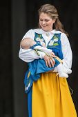 Princess Madeleine Of Sweden With Princess Leonore In Her Arms At The Opening Of The Stockholm Palac