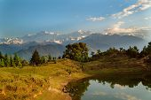 Deoria Tal Lake and Himalayas at sunrise