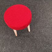 Red Stool On Gray Carpet Floor