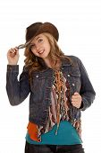 stock photo of cowgirl  - a woman in her cowgirl hat and jacket with a smile on her face - JPG