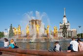 People Sitting Near Fountain In Moscow