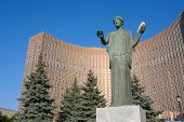 Female Statue With White Dove Against Cosmos Hotel In Moscow