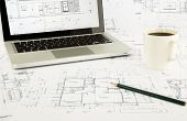 House Blueprints And Floor Plan With Laptop