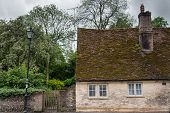 stock photo of sag  - Old English house with a sagging roofline - JPG