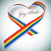 a rainbow ribbon forming a heart and the text gay pride