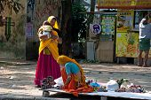 Indian Women In Colorful Sari With Baby Sells Souvenirs