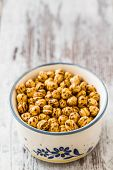picture of chickpea  - Roasted chickpeas in porcelain plate on wooden white background - JPG