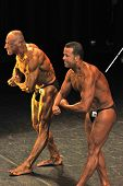 Two Male Bodybuilders Showing Their Most Muscular Pose