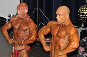 Two Male Bodybuilders Showing Their Chest Pose