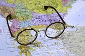 Glasses on a map of europe - Greece