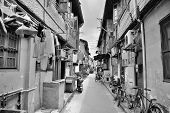 Old street in Shanghai with residential buildings in black and white