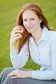 Office Employee With An Apple In A Park
