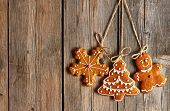 Christmas homemade gingerbread cookies over wooden background