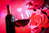 Two Red Wine Glasses On Blur Red Roses Background
