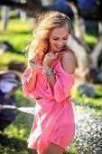 Beautiful Blonde Woman Posing In The Park