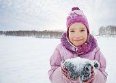 Child in winter. Happy girl