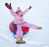 image of toboggan  - Child sledding in winter hill - JPG