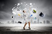 pic of juggling  - Young pretty businesswoman juggling with white balls - JPG
