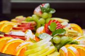cutting fruits on plate. sweet food