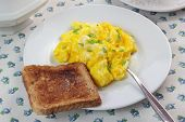 Scrambled eggs and toast.