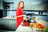 Beautiful woman housewife prepares healthy food in the kitchen. Healthy eating. Home interior.