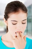 image of vomiting  - Woman putting her finger in mouth to provoke vomiting - JPG