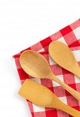 wooden kitchen tools at cloth napkins isolated on white background