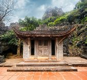 foto of dong  - Ancient buddhist pagoda cave complex Bich Dong - JPG
