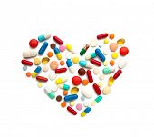 Some different pills in a heart form