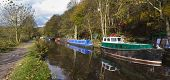 pic of barge  - Barge on the canal in autumn England UK - JPG