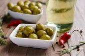 Marinated olives on table close-up