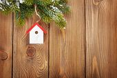 Christmas fir tree and birdhouse decor on rustic wooden board with copy space