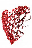 Red ribbons shaped as hearts on white background