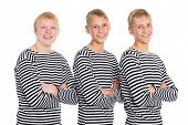 Guys blondes in a striped shirt with arms crossed. Two of the boys twin brothers.