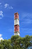foto of chp  - High industrial chimney against the blue sky - JPG