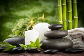 spa concept with zen basalt stones and candles