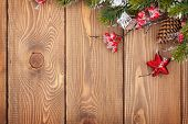 Christmas wooden background with snow fir tree and decor with copy space