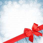 Red ribbon with bow over christmas snow background with copy space