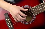 Photo of woman's hand on guitar