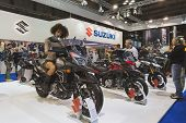 Beautiful Model Posing On Suzuki Motorbike At Eicma 2014 In Milan, Italy