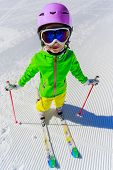 Skiing, winter vacation - young skier on mountainside