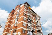 foto of brownstone  - old high apartment block of red brick - JPG