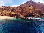 pic of inlet  - beautiful ocean inlet by a mountain in cabo san lucas - JPG