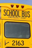 a typical american school bus in yellow color