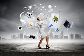 picture of juggling  - Young pretty businesswoman juggling with white balls - JPG