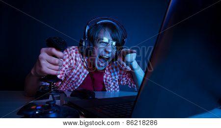 Emotional kid play video game