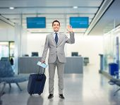 image of waving hands  - business trip - JPG
