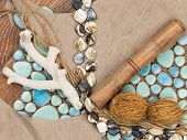 foto of mother-of-pearl  - selection of materials for interior decoration in a nautical style with ceramic mosaics similar to the sea pebbles a linen cloth pearl beads salted wood twine and plant seeds - JPG