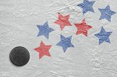 picture of hockey arena  - Hockey puck and a schematic representation of the American flag - JPG