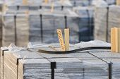 stock photo of nylons  - Close up of packed flagstones on pallets and wrapped in nylon - JPG